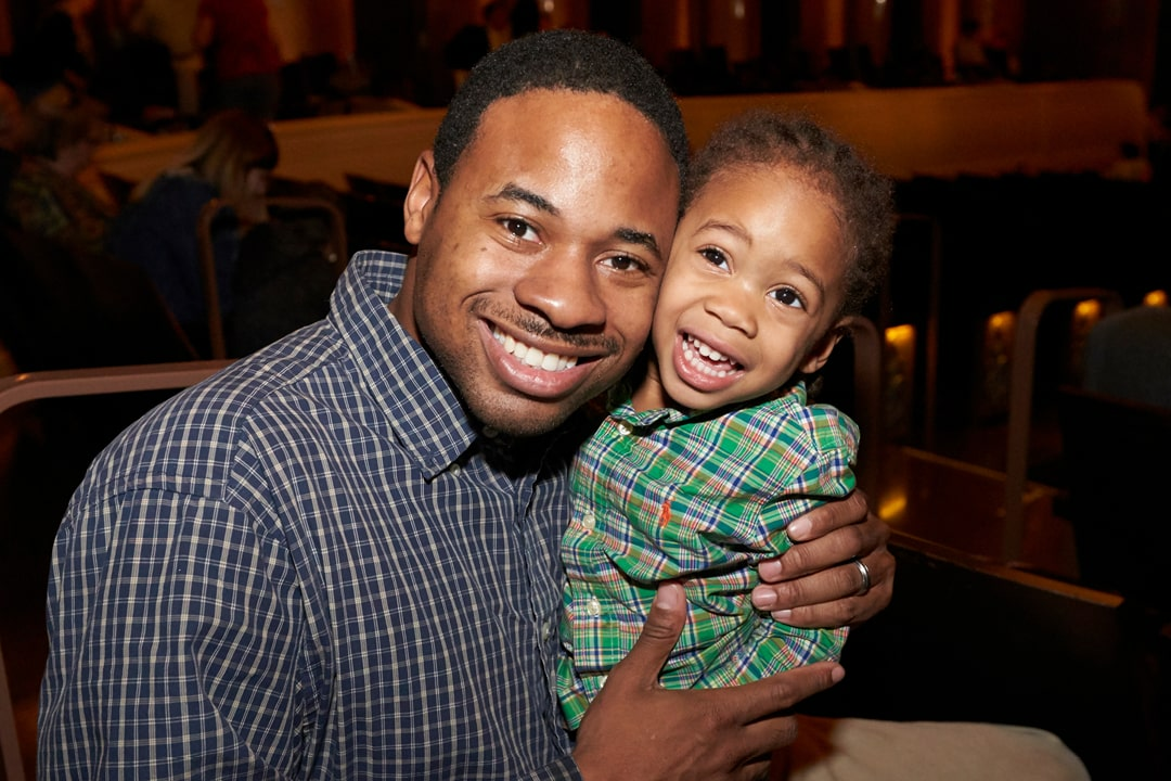 A photo of a father and son at The Smith Center for a sensory friendly performance