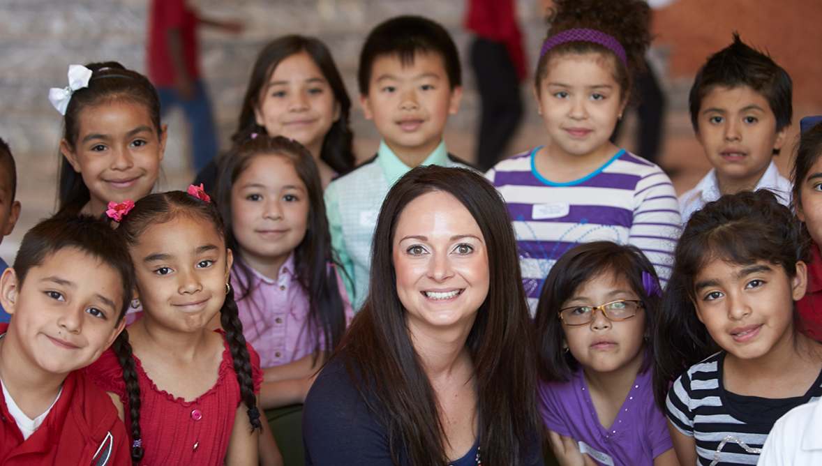 A teacher surrounded by her students at a Smith Center performance
