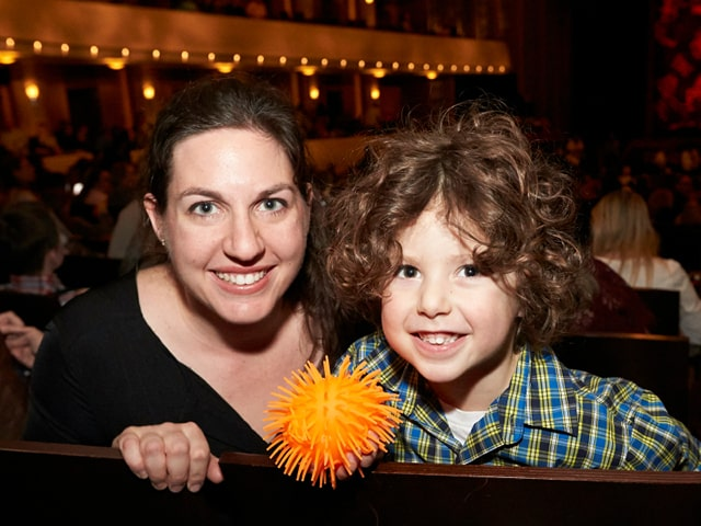 A photo of a mother and son at The Smith Center for a sensory friendly performance