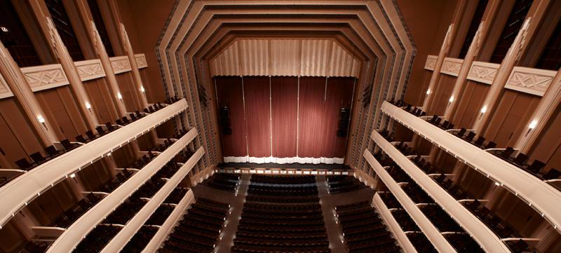 Image of Reynolds Hall stage with curtain drawn