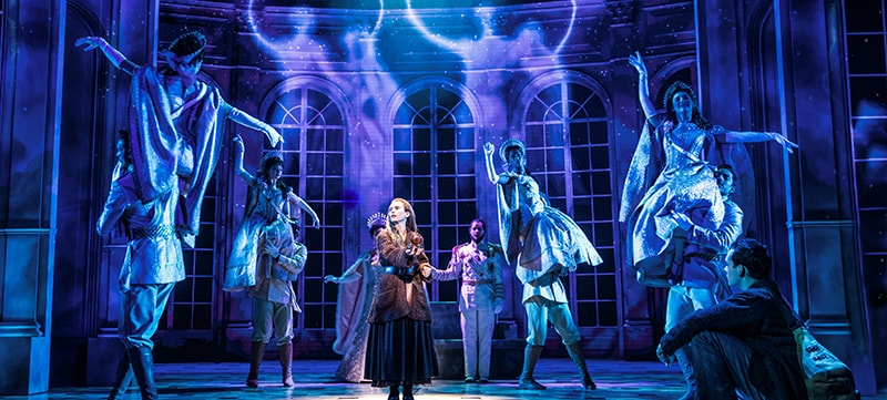"Image of cast members on stage in the Broadway Las Vegas show ""Anastasia"""