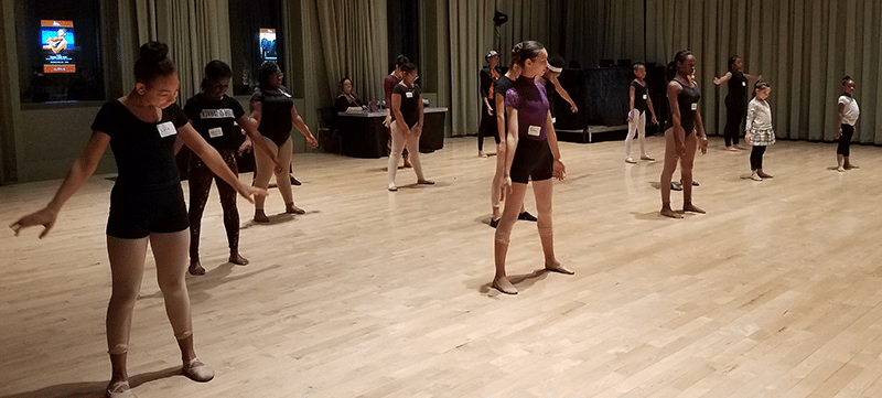 Local students participating in dance workshop in Troesh Studio Theater