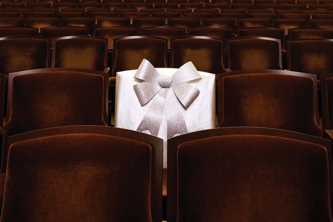 A photo of a theater seat wrapped up like a present