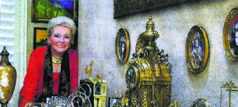 Janice Haupt Allen with her clock collection