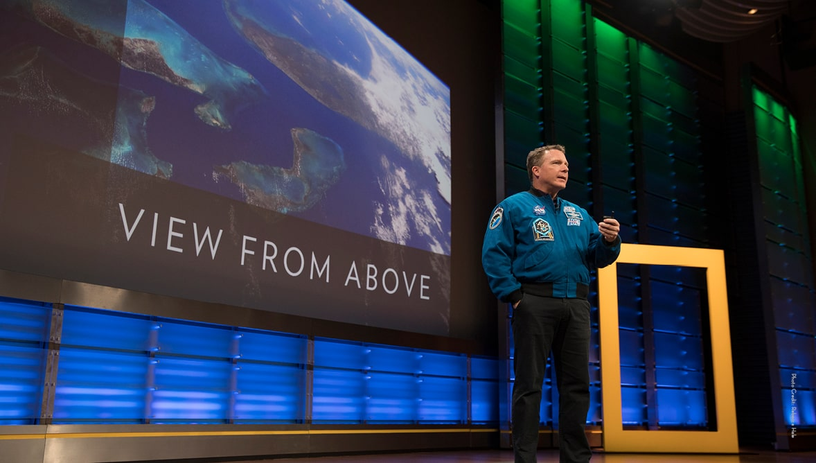 "Image of Terry Virts on stage presenting ""View from Above"" for National Geographic Live!"