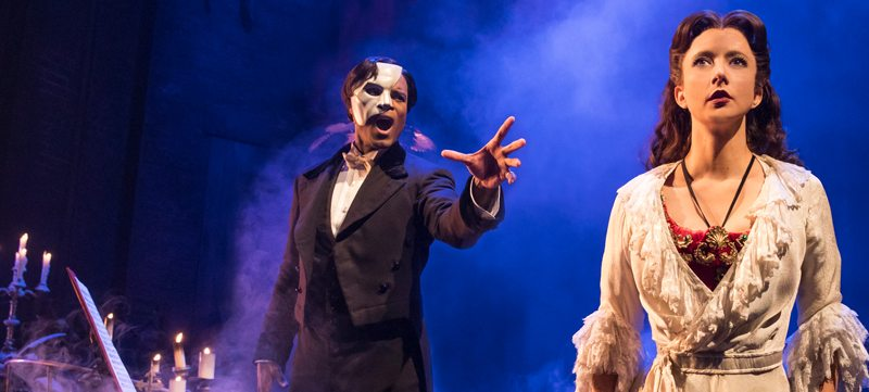 "Cast members on stage in ""The Phantom of the Opera"""