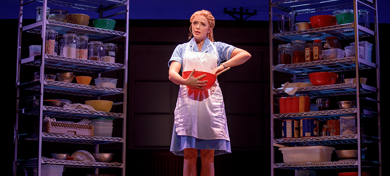 "Cast member on stage in ""Waitress"""