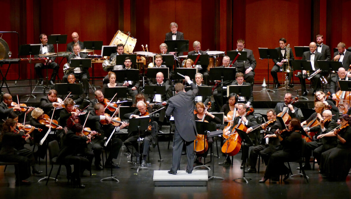 A photo of Donato Cabrera conducting the Las Vegas Philharmonic Orchestra.