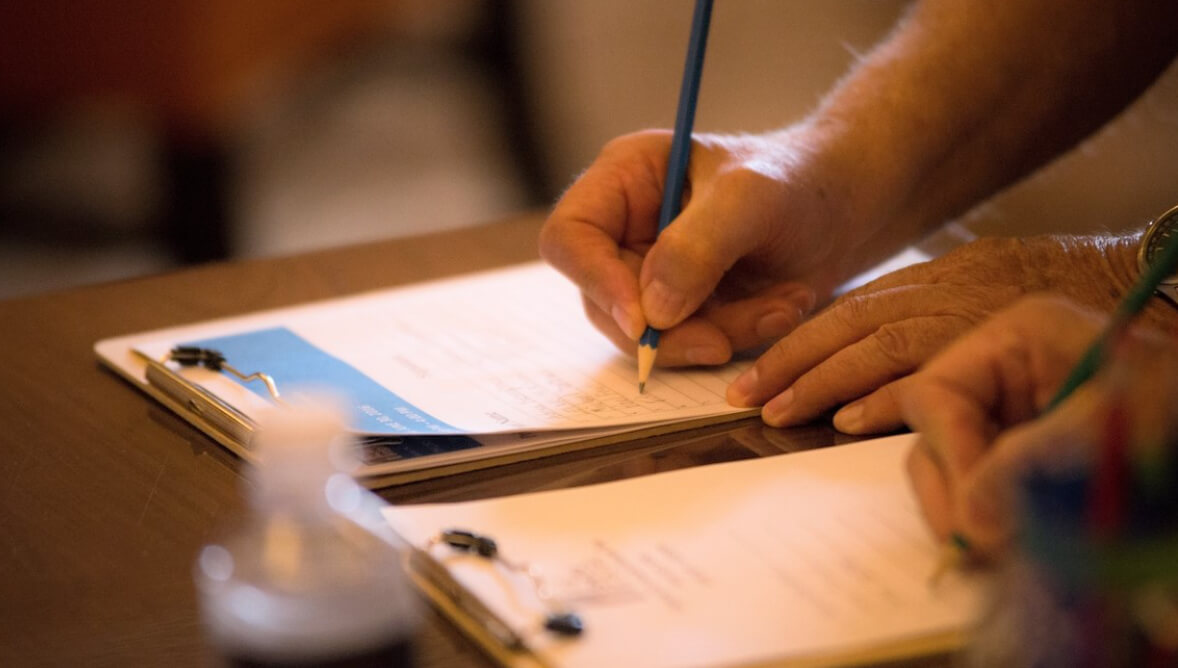 A photo of a person filling out a form.