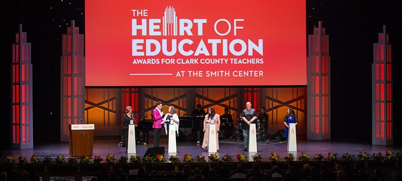 Image of Heart of Education winners on stage receiving their awards.