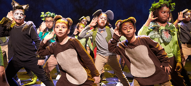 "A photo of students preforming Disney musical ""The Jungle Book."""