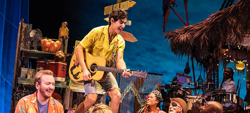 "Cast members on stage in ""Jimmy Buffet's Escape to Margaritaville"""